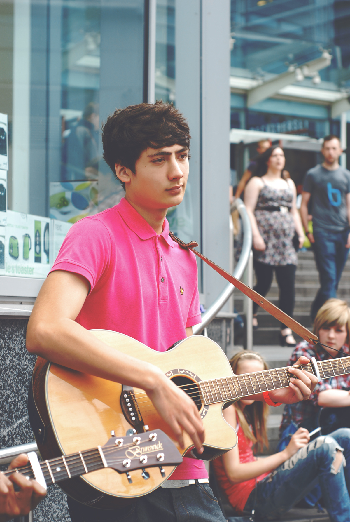 A photograph of a young street musician